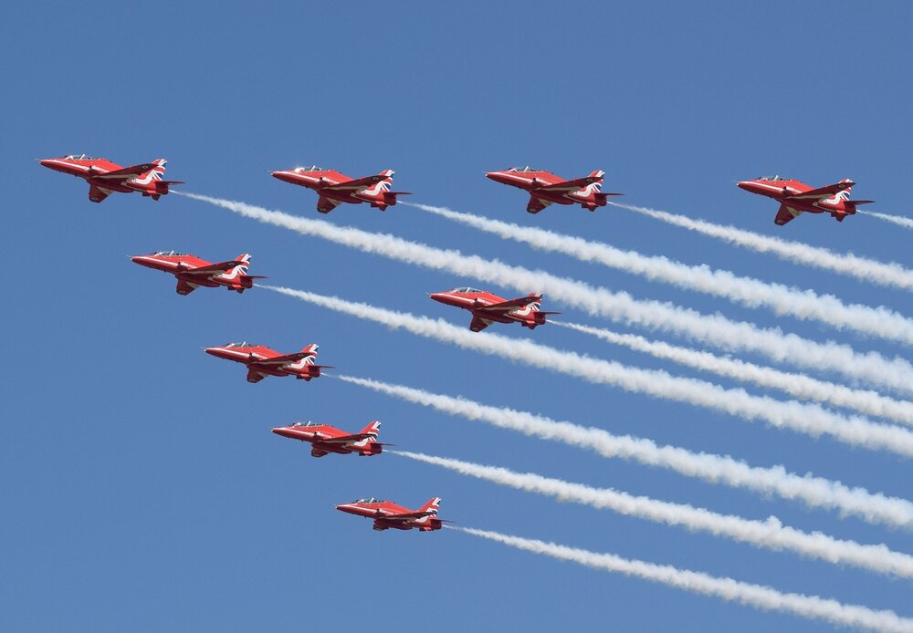 Nine_BAE_Hawks_of_the_UK_Red_Arrows_at_the_2018_RIAT,_England.jpg